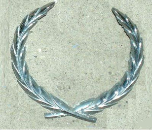 "TRUNK LID EMBLEM, ""WREATH"", USED"
