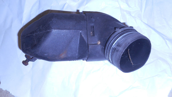 AIR CLEANER HEAT RISER ELBOW ,USED PLASTIC 71-79 CADDY