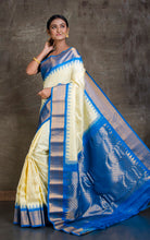 Exclusive Gadwal Silk Saree in Butter Milk and Azure Blue