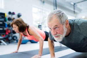 older man and woman exercising