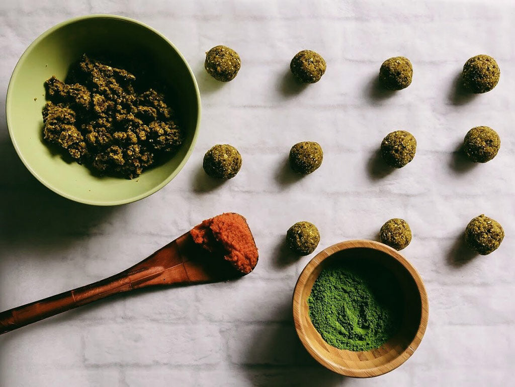 Matcha pumpkin bliss balls before powdering