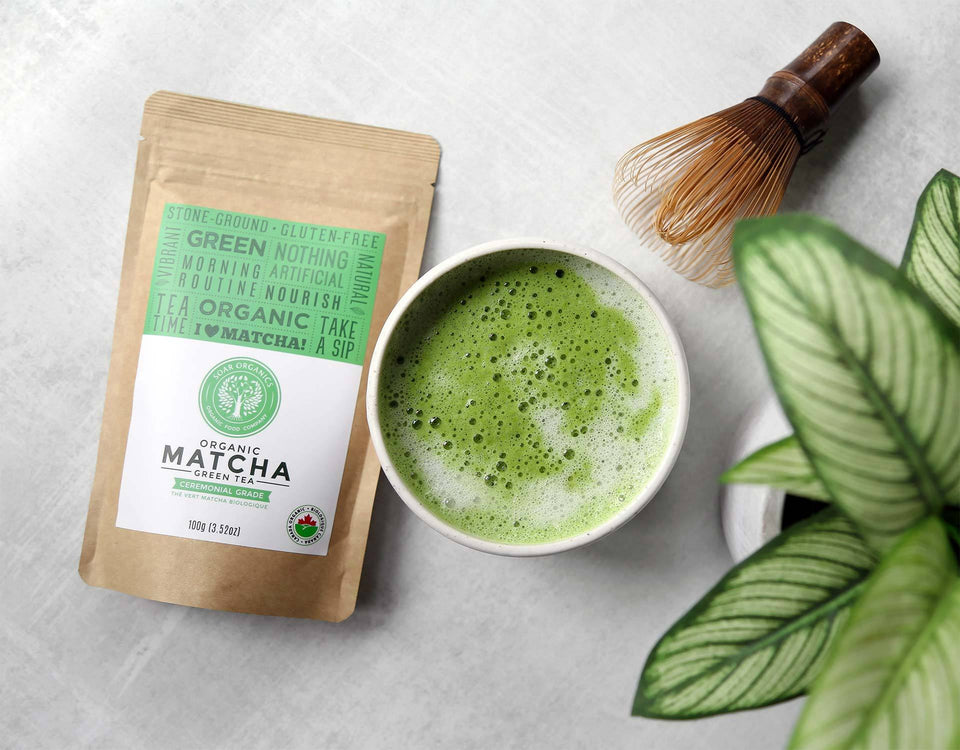 Soar Organics Ceremonial Matcha Powder with latte and whisk