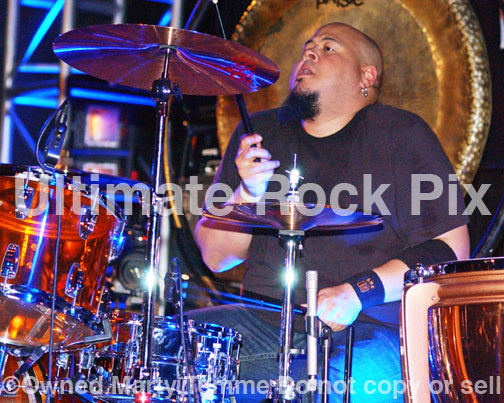 Photo of drummer Abe Laboriel Jr. in concert by Marty Temme