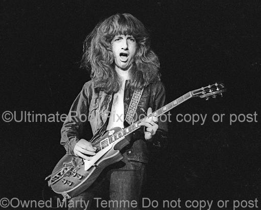Photos of guitarist Brad Whitford of Aerosmith playing a Gibson Les Paul in concert in 1974 by Marty Temme
