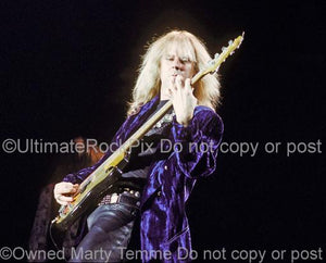 Photos of bass player Tom Hamilton onstage in 1990 by Marty Temme