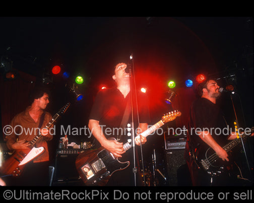 Photo of Rick McCollum, Greg Dulli and John Curley of The Afghan Whigs in concert in 1999 by Marty Temme