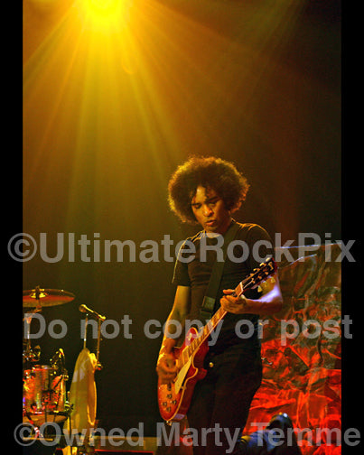 Photo of William DuVall of Alice in Chains playing a Les Paul in concert in 2010 by Marty Temme