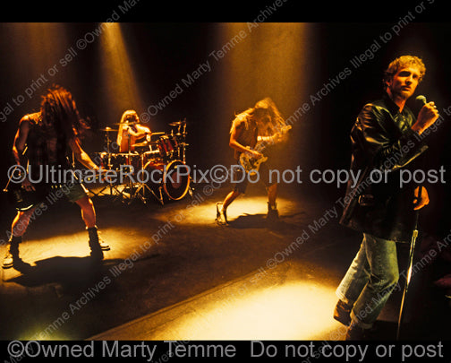 Photo of Alice in Chains performing in 1991 by Marty Temme