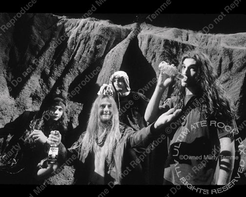 Black and white photo of Alice in Chains during a photo shoot in 1992