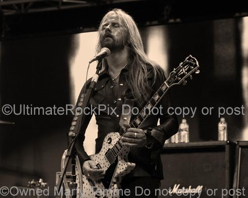 Sepia tint photos of Jerry Cantrell of Alice in Chains Playing a Gibson Les Paul Guitar in Concert in 2010 by Marty Temme