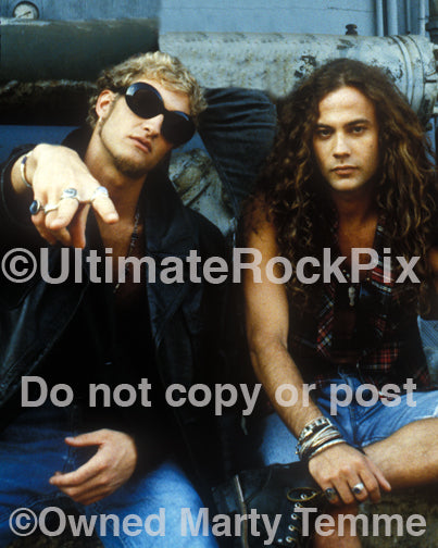 Photo of Layne Staley and Mike Starr of Alice in Chains during a photo shoot in 1991 in Hollywood, California by Marty Temme