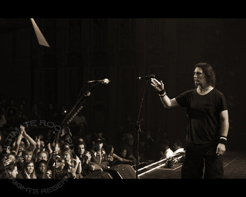 Art Print of Sean Kinney of Alice in Chains throwing a drumstick to the crowd in 2006 by Marty Temme