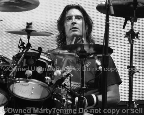Black and white photo of Sean Kinney of Alice In Chains in concert in 2006 by Marty Temme