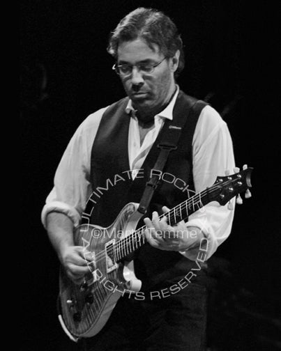 Black and white photo of guitar player Al Di Meola in concert by Marty Temme