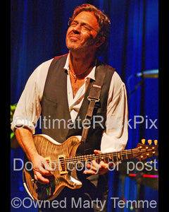 Photo of guitar player Al Di Meola in concert in 2006 by Marty Temme