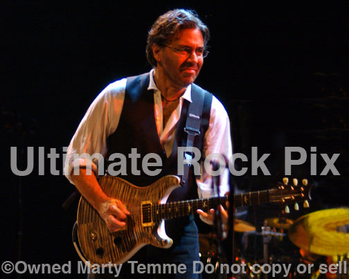 Photo of Al Di Meola playing a PRS guitar in concert in 2006 by Marty Temme