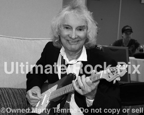 Black and white photo of guitarist Albert Lee backstage in 2012 by Marty Temme