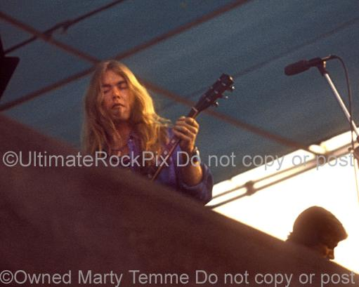 Photos of Musician Gregg Allman of The Allman Brothers Playing a Gibson Les Paul in Concert in 1974 by Marty Temme