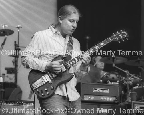 Black and White Photos of Guitar Player Derek Trucks of The Allman Brothers Playing in Concert by Marty Temme