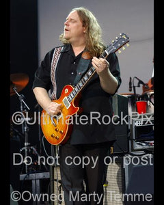 Photos of Warren Haynes of The Allman Brothers Playing a Les Paul in Concert by Marty Temme