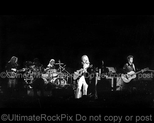 Photo of Gerry Beckley, Dewey Bunnell, Willie Leacox and Dan Peek of the band America in concert in 1977 by Marty Temme