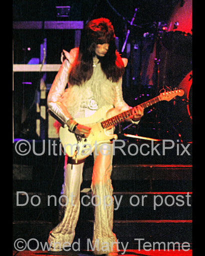 Photo of guitarist Punky Meadows of Angel in concert in 1977 by Marty Temme