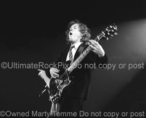 Photos of Angus Young of AC/DC in Concert by Marty Temme