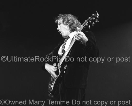 Photos of Angus Young of AC/DC Playing a Gibson SG by Marty Temme