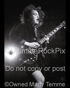 Photos of Angus Young of AC/DC Playing a Gibson SG in Concert by Marty Temme
