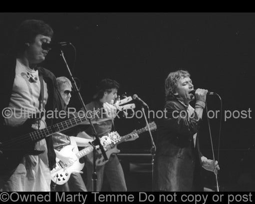 Photo of singer Eric Burdon and The Animals in concert in 1983 by Marty Temme