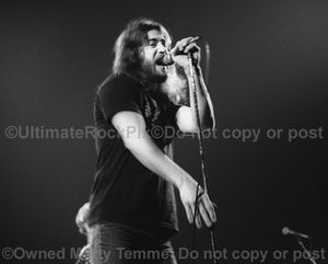 Photo of Ronnie Hammond of Atlanta Rhythm Section in concert in 1978 by Marty Temme