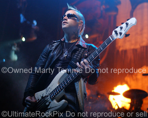 Photo of bass player Johnny Christ of Avenged Sevenfold in concert by Marty Temme