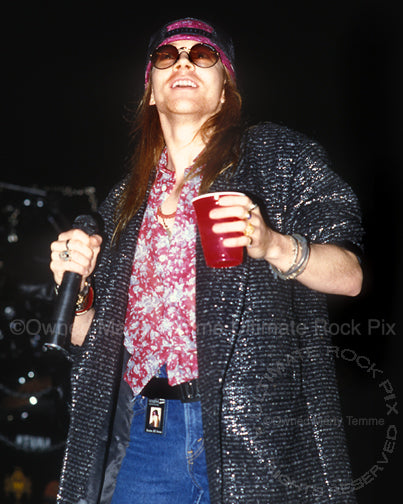 Photo of singer Axl Rose of Guns N' Roses in concert in 1989 by Marty Temme