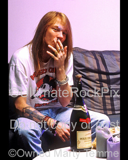 Photo of Axl Rose of Guns N' Roses during a photo shoot in 1990 at his home in Hollywood, California by Marty Temme