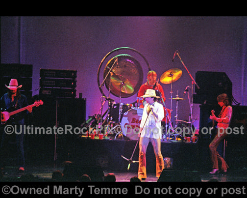Photo of Bad Company in concert in 1977 by Marty Temme