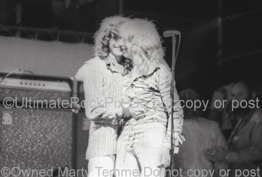 Photo of Mick Ralphs and Jimmy Page playing together in concert in 1974 by Marty Temme