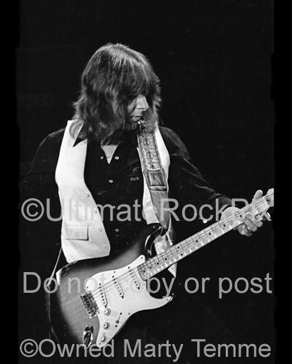 Black and White Photo of Mick Ralphs of Bad Company Playing a Fender Stratocaster in Concert in 1979 by Marty Temme
