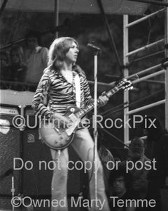 Black and white photo of Mick Ralphs of Bad Company playing a Les Paul onstage in 1974 by Marty Temme