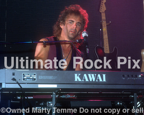 Photo of keyboard player Jonathan Cain of Bad English and Journey in concert in 1989 by Marty Temme