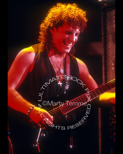 Photo of Neal Schon of Bad English and Journey in concert by Marty Temme