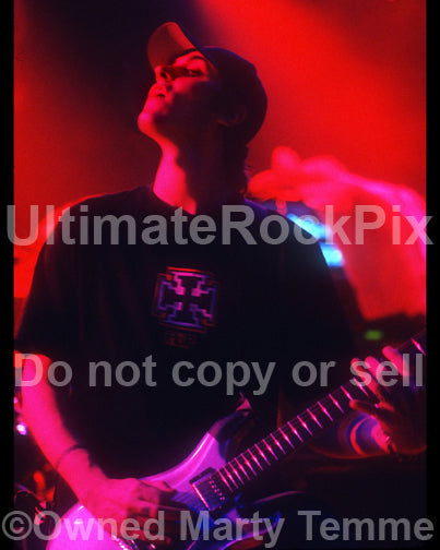 Photo of Benjamin Burnley of Breaking Benjamin playing guitar in concert by Marty Temme