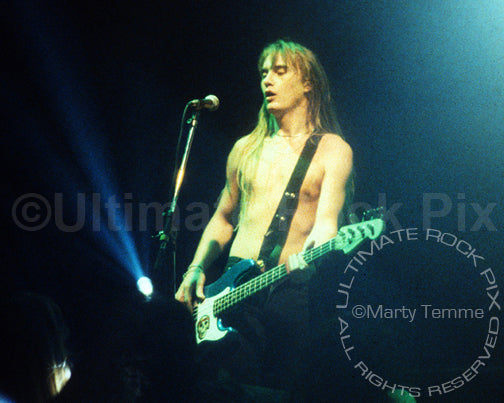 Photo of bassist Lonnie Vencent of BulletBoys in concert in 1989 by Marty Temme