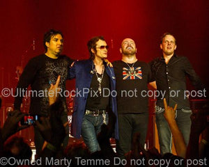 Photo of Joe Bonamassa, Glenn Hughes, Jason Bonham and Derek Sherinian of Black Country Communion Standing Together After the Concert Encore in 2011 by Marty Temme