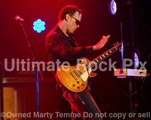 Photo of Joe Bonamassa playing a Les Paul and a theremin in concert by Marty Temme