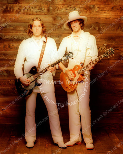 Photo of Rich Robinson and Audley Freed of The Black Crowes during a photo shoot in 1998 by Marty Temme
