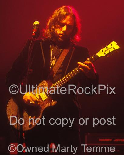Photo of guitarist Rich Robinson of The Black Crowes and The Magpie Salute playing a James Trussart guitar onstage in 2008 by Marty Temme