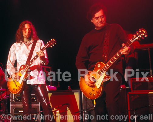 Photo of Jimmy Page of Led Zeppelin and Rich Robinson of The Black Crowes in Concert by Marty Temme