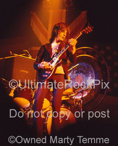 Photo of Jeff Beck playing his Oxblood Les Paul in concert in 1973 by Marty Temme