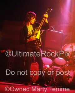 Photo of Jeff Beck playing his Oxblood Les Paul onstage in 1973 by Marty Temme