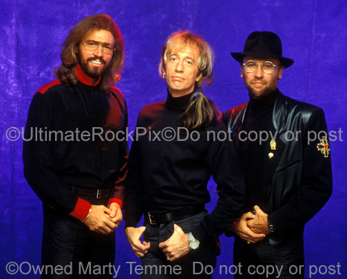 Photo of The Bee Gees during a photo shoot in 1991 by Marty Temme